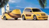 """A SEMA show standout in Las Vegas was this DaimlerChrysler PT Cruiser customized by Canadian Tier One OE supplier Decoma International Inc. The Woody Street Rod garnered three awards at the show, including both the design excellence and design application awards from DaimlerChrysler Corporation. Decoma intends to offer OEM's the capability to """"customize"""" vehicles at the factory to target regional or niche markets."""