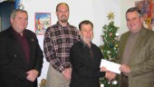 Present for the charitable contribution were (l-r) Ken Coulter, Shad's R&R, Bryan Lauder and Harvey Presement, World Automotive, and John Vanstone, Shad's R&R.