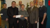 Personnel from World Automotive joined in presenting Shad's R&R charity board members with a cheque in its annual Christmas contribution. (l-r) are David Lewis, John Vanstone, Shad's, Bryan Lauder, Harvey Presement, Ken Coulter, Shad's, and Randy Slinger.