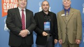 Jason Best, VP sales and marketing at Spectra Premium (middle), receiving the award.