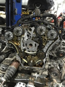 A 3.6 V6 GM engine removed from the vehicle, about to have timing chains and guides replaced.