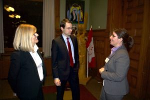 Deborah Lamb, the senior communications advisor to MPP Tracy MacCharles (left), and Luca Manfredi, the legislative assistant to MPP Jim McDonnell (Stormont-Dundas-South Glengarry), meet with France Devault, AIA's senior director for stakeholder relations.