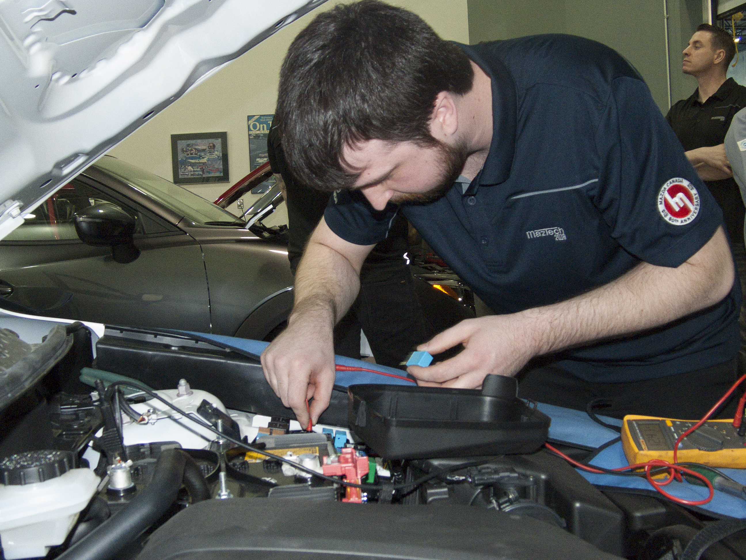 Adam Bochek diagnoses a vehicle at the 2018 Canadian MazTech Service Skills Competition in Toronto.