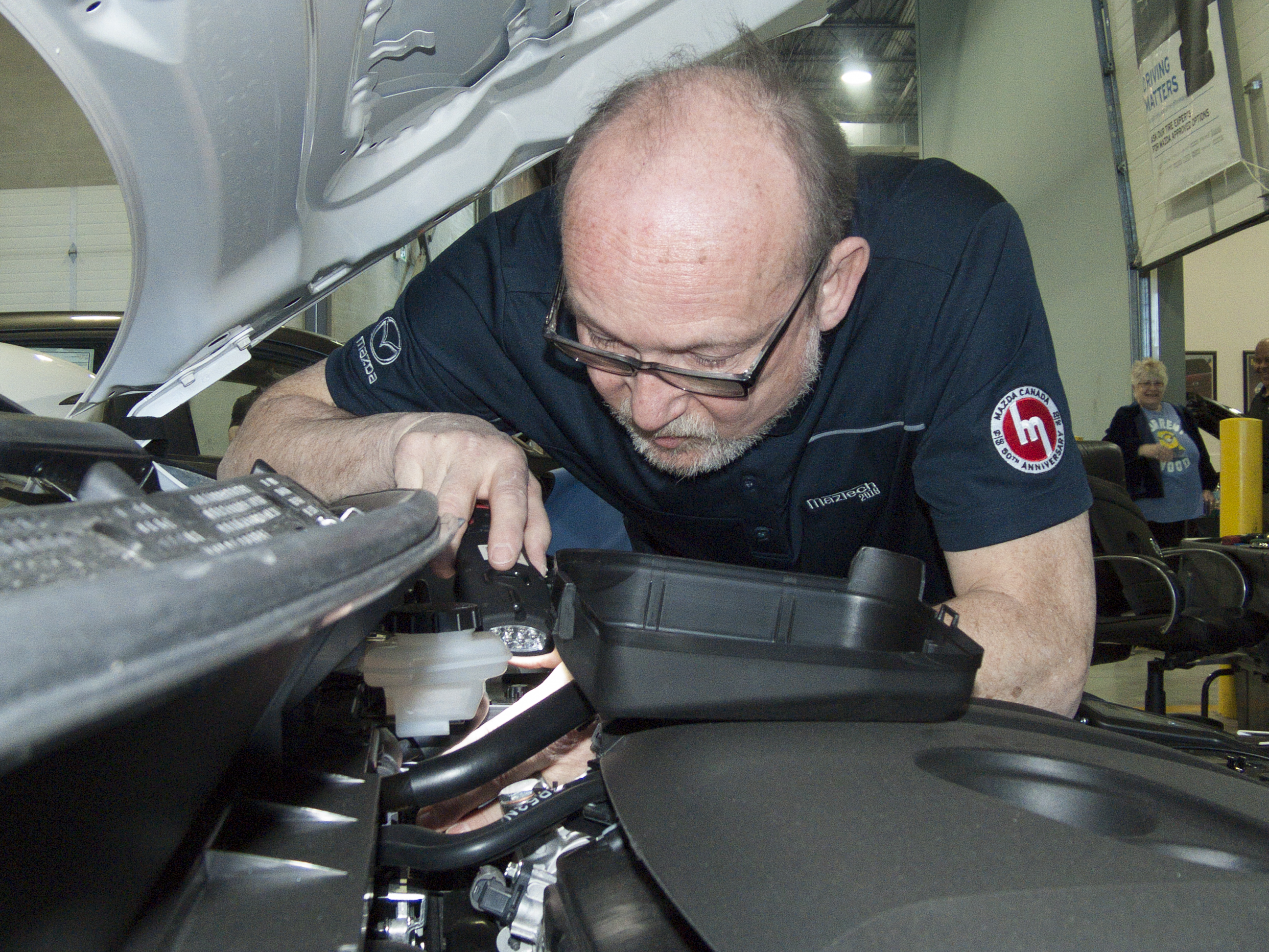 Glenn Bonderud diagnoses a vehicle at the 2018 Canadian MazTech Service Skills Competition in Toronto.