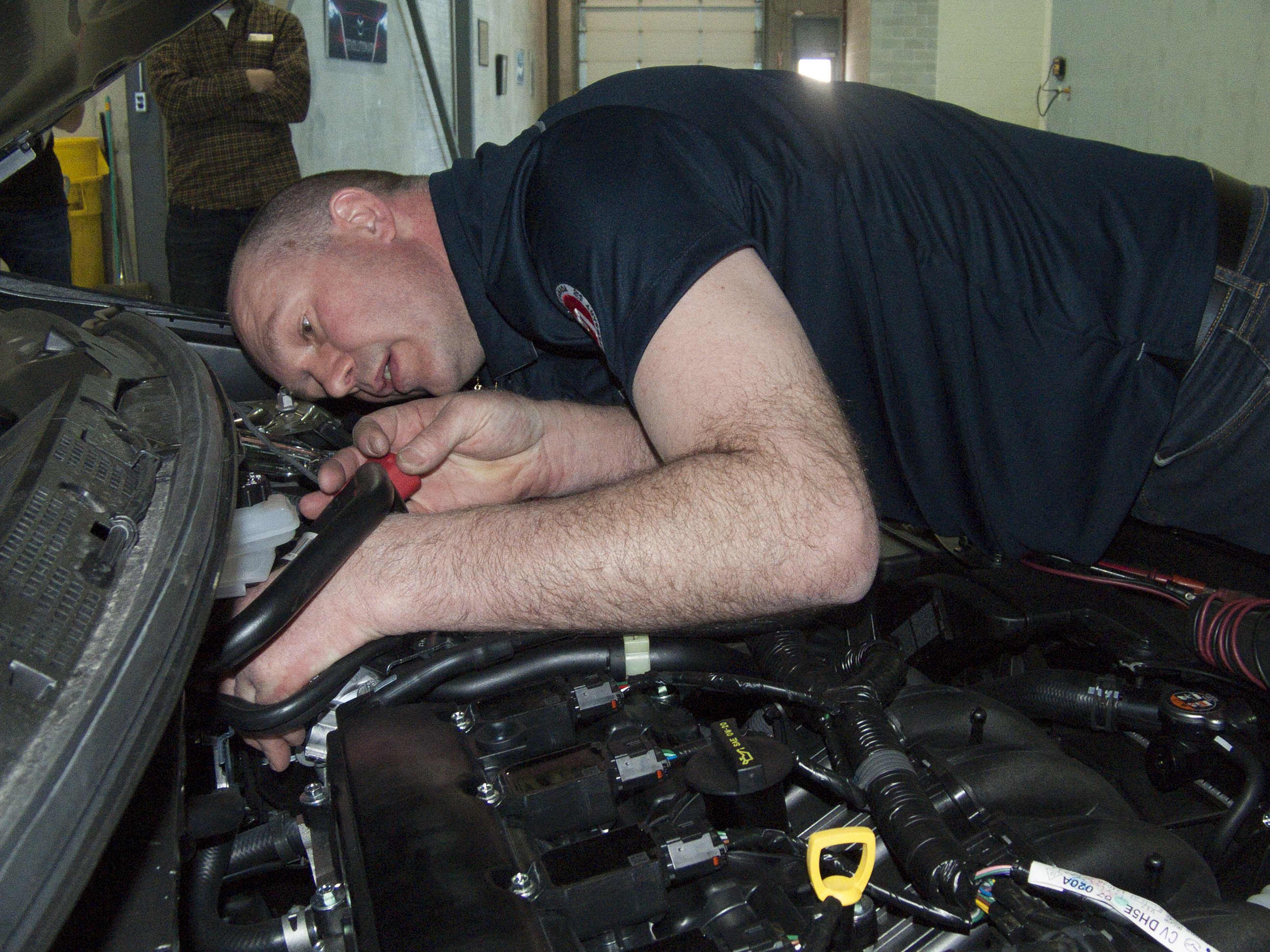 David Deweerd diagnoses a vehicle at the 2018 Canadian MazTech Service Skills Competition in Toronto.