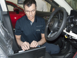 Christian Maheux diagnoses a vehicle at the 2018 Canadian MazTech Service Skills Competition in Toronto.