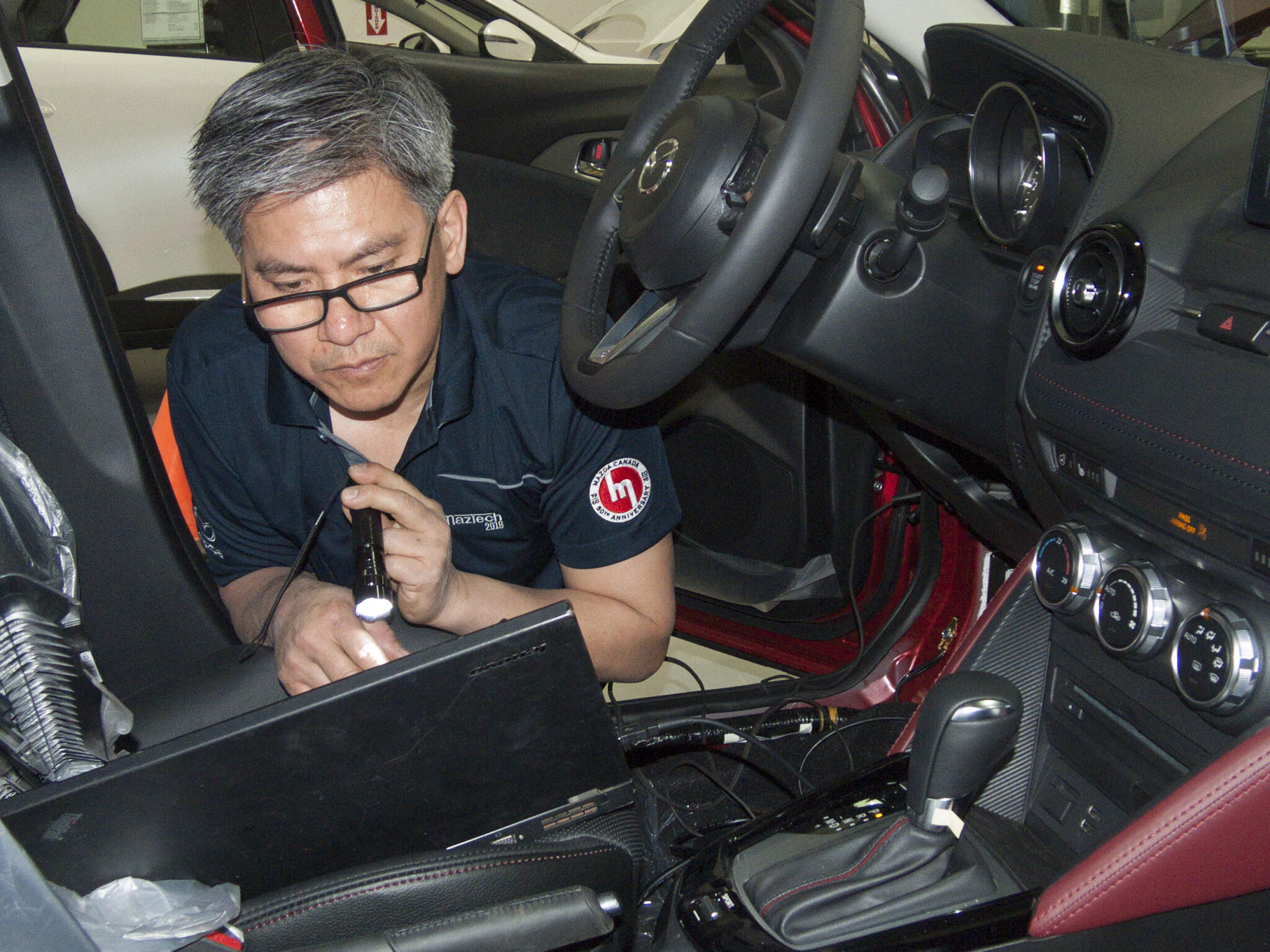 Perry Phuong diagnoses a vehicle at the 2018 Canadian MazTech Service Skills Competition in Toronto.