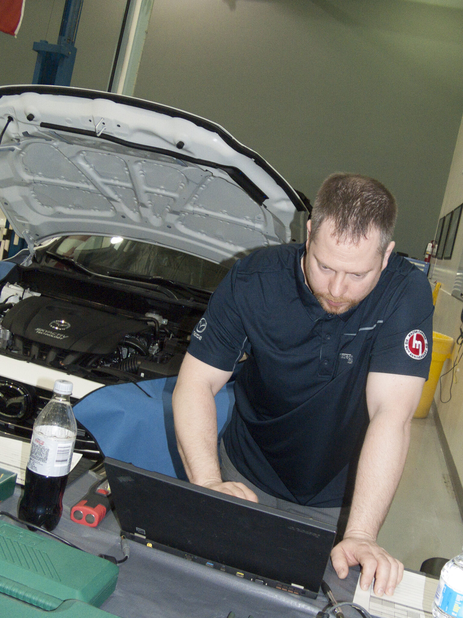 Cristopher Puckering diagnoses a vehicle at the 2018 Canadian MazTech Service Skills Competition in Toronto.
