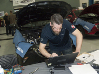 Dany St-Pierre diagnoses a vehicle at the 2018 Canadian MazTech Service Skills Competition in Toronto.