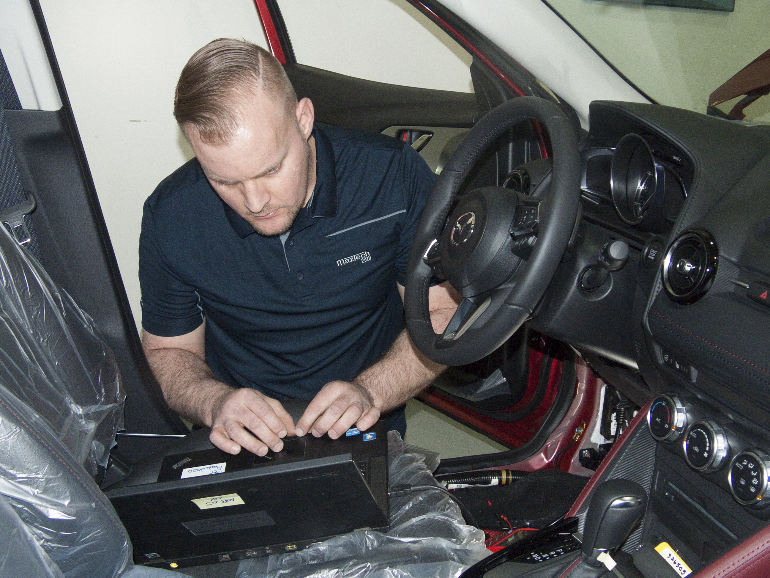 Jason Versteeg diagnoses a vehicle at the 2018 Canadian MazTech Service Skills Competition in Toronto.